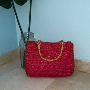 Red straw purse with bamboo handle